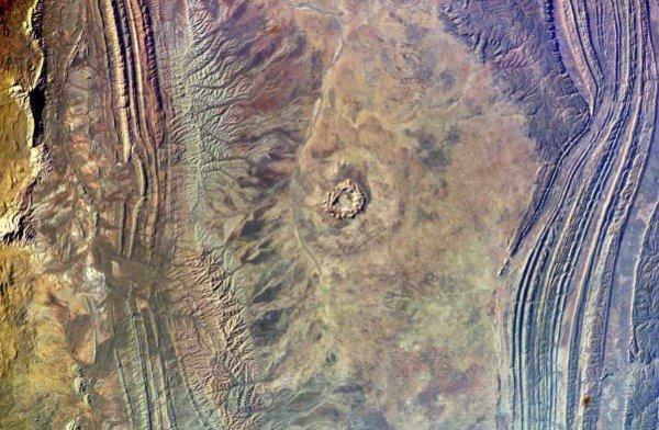 Израненная космосом Земля
